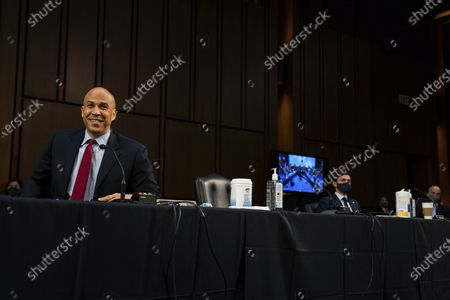 Sen. Cory Booker, Sen. NJ., smiling during a hearing for Judge Merrick Garland, nominee to be Attorney General, before the Senate Judiciary Committee, on Capitol Hill in Washington