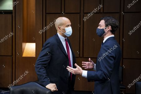 Sen. Cory Booker (D-NJ) speaks with Sen. Jon Ossoff (D-GA) during a break during Attorney General nominee Merrick Garland's confirmation hearing before the Senate Judiciary Committee in the Hart Senate Office Building, in Washington, DC., USA, 22 February 2021. Garland previously served as the Chief Judge for the US Court of Appeals for the District of Columbia Circuit.