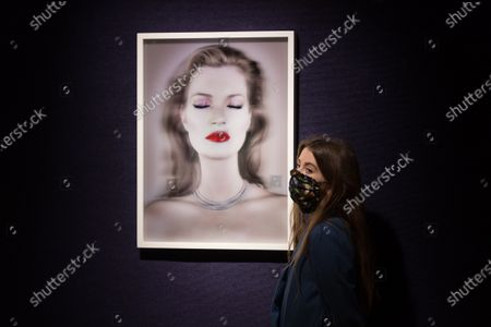 A gallery staff member stands next to 'Kate Moss She's Light (Pure)', 2014, 3D print by Chris Levine (est. £20,000-30,000) donated by both Levine and Moss to raise funds for Oxfam GB during a photo call for Bonhams' British. Cool. sale showcasing a diverse range of British and émigré talent from the last one hundred years, on February 22, 2021 in London, England. (Photo by WIktor Szymanowicz/NurPhoto)