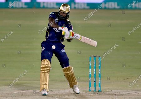 Quetta Gladiators' Chris Gayle plays a shot during a Pakistan Super League T20 cricket match between Lahore Qalandars and Quetta Gladiators at the National Stadium, in Karachi, Pakistan