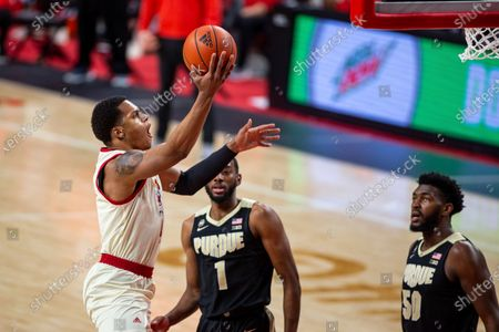 Stock Image of Nebraska guard Shamiel Stevenson (4) puts up a layup against Purdue forward Aaron Wheeler (1) and Purdue forward Trevion Williams (50) in the first half during an NCAA college basketball game, in Lincoln, Neb