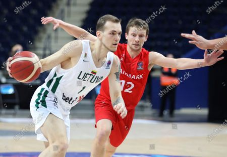 Denmark's Frederik Nielsen, right, and Lithuania's Arnas Velicka, left, challenge for the ball during the FIBA EuroBasket 2022 Group C qualifying basketball match between Denmark and Lithuania at Avia Soliutions Group arena in Vilnius, Lithuania