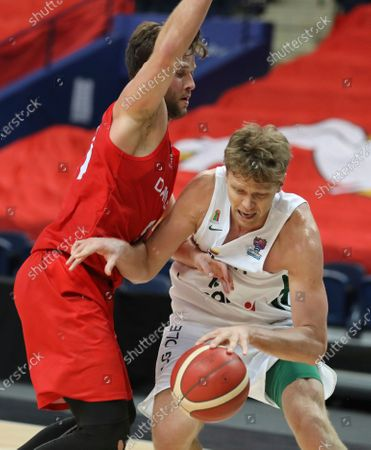 Stock Image of Denmark's Philip Hertz, left, and Lithuania's Mindaugas Kuzminskas, right, challenge for the ball during the FIBA EuroBasket 2022 Group C qualifying basketball match between Denmark and Lithuania at Avia Soliutions Group arena in Vilnius, Lithuania