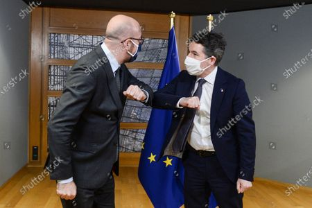 European Council President Charles Michel (L) gives an elbow bump greeting to Eurogroup President Paschal Donohoe (R), as they meet in Brussels, Belgium, 22 February 2021.