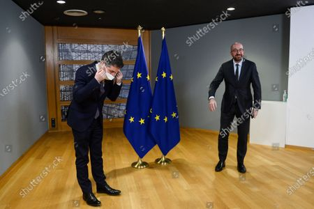 Stock Photo of Eurogroup President Paschal Donohoe (L) adjusts his face mask as he meets with European Council President Charles Michel (R), in Brussels, Belgium, 22 February 2021.