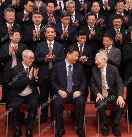 Stock Image of Chinese President Xi Jinping, also general secretary of the Communist Party of China (CPC) Central Committee and chairman of the Central Military Commission, has cordial exchanges with Sun Jiadong and Luan Enjie while meeting representatives of space scientists and engineers who participated in the research and development of the Chang'e-5 lunar mission in Beijing, capital of China, Feb. 22, 2021. Xi Jinping met representatives of space scientists and engineers who participated in the research and development of the Chang'e-5 lunar mission at the Great Hall of the People in Beijing on Monday.     Xi also visited an exhibition on the lunar samples brought back by the Chang'e-5 probe and China's lunar exploration achievements as well.    Li Keqiang, Li Zhanshu, Wang Yang, Wang Huning, Zhao Leji, and Han Zheng, all members of the Standing Committee of the Political Bureau of the CPC Central Committee, also attended the event.