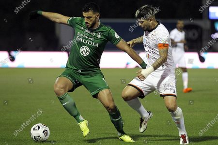 Al-Shabab's player Ever Banega (R) in action against Al-Ahli's Omar Al-Somah (L) during the Saudi Professional League soccer match between Al-Shabab and Al-Ahli at Prince Khalid bin Sultan Stadium, in Riyadh, Saudi Arabia, 22 February 2021.