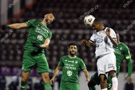 Al-Shabab's player Abdullah Al-Zoari (R-front) in action against Al-Ahli's Omar Al-Somah (L) during the Saudi Professional League soccer match between Al-Shabab and Al-Ahli at Prince Khalid bin Sultan Stadium, in Riyadh, Saudi Arabia, 22 February 2021.