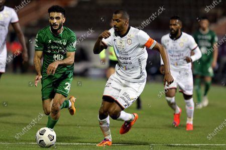 Al-Shabab's player Abdullah Al-Zoari (R) in action against Al-Ahli's Mohammed Al-Majhad (L) during the Saudi Professional League soccer match between Al-Shabab and Al-Ahli at Prince Khalid bin Sultan Stadium, in Riyadh, Saudi Arabia, 22 February 2021.
