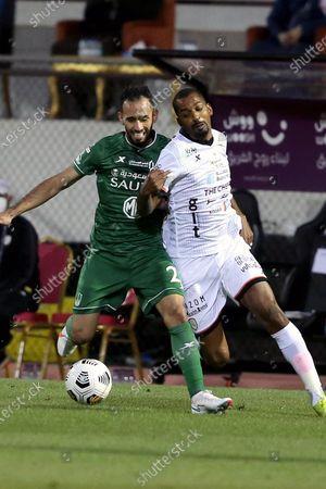Stock Photo of Al-Shabab's player Abdullah Al-Zoari (R) in action against Al-Ahli's Sultan Mandash (L) during the Saudi Professional League soccer match between Al-Shabab and Al-Ahli at Prince Khalid bin Sultan Stadium, in Riyadh, Saudi Arabia, 22 February 2021.