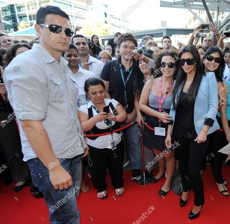 Kim Kardashian West (R) and bodyguard Shengo Deane