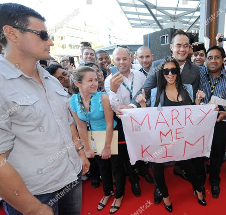 Kim Kardashian West (R) and bodyguard Shengo Deane (L)