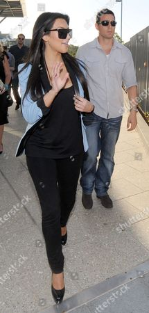 Stock Image of Kim Kardashian West and bodyguard Shengo Deane