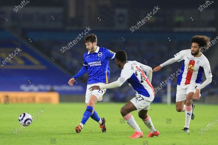 Stock Picture of Brighton and Hove Albion midfielder Adam Lallana (14) battles with Crystal Palace #27 Tyrick Mitchell during the Premier League match between Brighton and Hove Albion and Crystal Palace at the American Express Community Stadium, Brighton and Hove