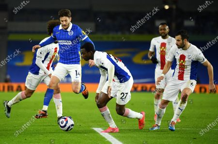 Adam Lallana of Brighton in action against Tyrick Mitchell (C) of Crystal Palace during the English Premier League soccer match between Brighton Hove Albion and Crystal Palace in Brighton, Britain, 22 February 2021.
