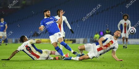 Alireza Jahanbakhsh (C) of Brighton in action against Gary Cahill (R) and Jordan Ayew of Crystal Palace during the English Premier League soccer match between Brighton Hove Albion and Crystal Palace in Brighton, Britain, 22 February 2021.