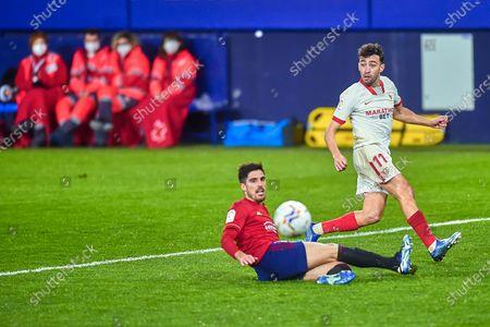 Munir El Haddadi of Sevilla FC and Nacho Vidal of CA Osasuna