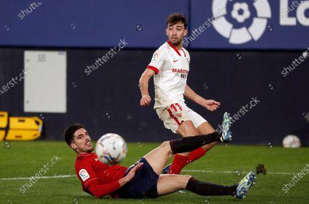 Sevilla's Munir El Haddadi (R) in action against Nacho Vidal (L) of Osasuna during a Spanish LaLiga soccer match between Osasuna and Sevilla FC at El Sadar stadium in Pamplona, Navarra, northern Spain, 22 February 2021.