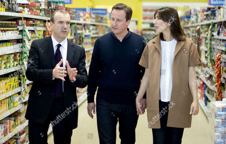 Sir Terry Leahy, Chief Executive of Tesco with  David Cameron and pregnant wife Samantha during a Q&A at Tesco in Holywell, Flintshire, North Wales