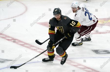 Stock Picture of Vegas Golden Knights center Nicolas Roy, front, drives past Colorado Avalanche left wing Brandon Saad in the first period of an NHL hockey game, in Denver