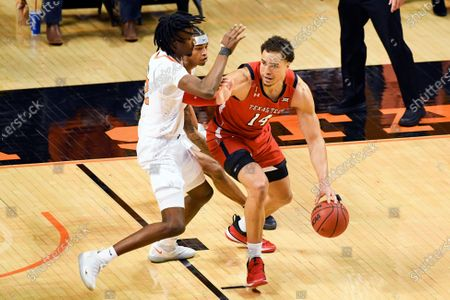 Oklahoma State forward Kalib Boon, left, and guard Avery Anderson II,I center, defend against Texas Tech forward Marcus Santos-Silva during an NCAA college basketball game, in Stillwater, Okla