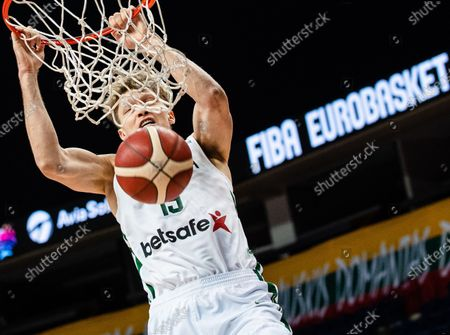 Stock Photo of Mindaugas Kuzminskas of Lithuania dunks during a FIBA EuroBasket 2022 qualifying basketball match between Lithuania and Denmark in Vilnius, Lithuania, on Feb. 22, 2021.