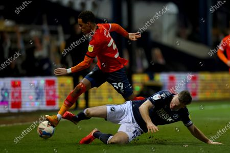 Alex Pearce of Millwall challenges Thomas Ince of Luton Town; Kenilworth Road, Luton, Bedfordshire, England; English Football League Championship Football, Luton Town versus Millwall.