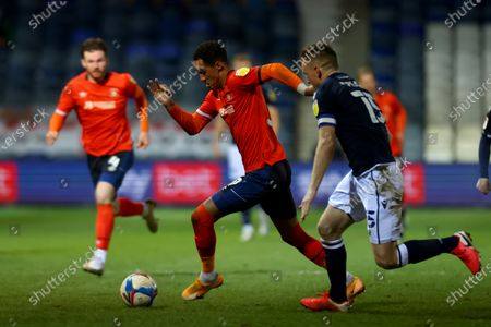 Thomas Ince of Luton Town competes for the ball with Alex Pearce of Millwall; Kenilworth Road, Luton, Bedfordshire, England; English Football League Championship Football, Luton Town versus Millwall.