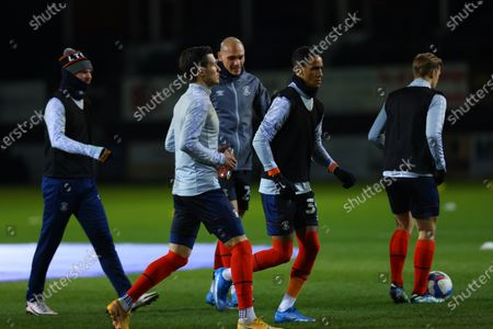 Thomas Ince of Luton Town during the warm up with team mates; Kenilworth Road, Luton, Bedfordshire, England; English Football League Championship Football, Luton Town versus Millwall.