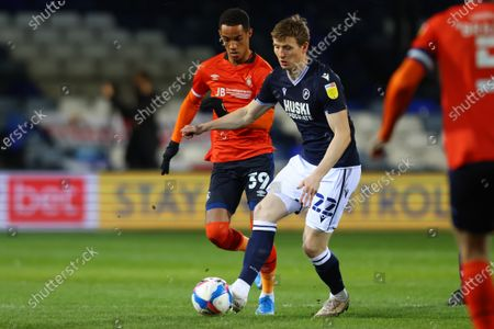 Jon Daoi Boovarsson of Millwall under pressure from Thomas Ince of Luton Town; Kenilworth Road, Luton, Bedfordshire, England; English Football League Championship Football, Luton Town versus Millwall.