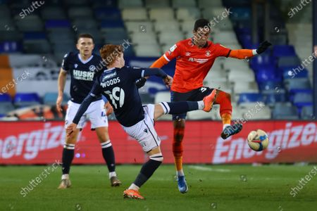 Ryan Woods of Millwall challenges Thomas Ince of Luton Town; Kenilworth Road, Luton, Bedfordshire, England; English Football League Championship Football, Luton Town versus Millwall.