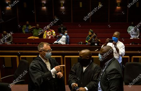 State prosecutor Advocate Billy Downer (L) greets the lawyers representing former President Jacob Zuma at the Pietermaritzburg High Court in Pietermaritzburg, South Africa, 23 February 2021. South Africa's former President Zuma skipped court appearance on 23 February after an agreement was reached to postpone to May 17 2021 his trial over corruption, fraud and money laundering charges. Zuma stands accused of taking kickbacks before he became president from a 51 billion rand (3.4 billion US dollar) purchase of fighter jets, patrol boats and military equipment manufactured by five European firms, including French defence company Thales.
