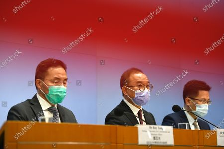 Stock Photo of From Left to Right Mr Roy Tang permanent Secretary for Constitutional and Mainland Affairs, Mr Eric Tsang Kowk-Wai Secretary For Constitutional and Mainland Affairs and Mr Lawerence Peng Deputy Law Draftsman of Department of Justice, during a press conference , on the amendment of public offices (Candidacy and taking up offices) bill ,  in the central Government office, in Hong Kong, Tuesday, Feb 23, 2021.  The amendment will require district council members to swear allegiance to the Government and Beijing