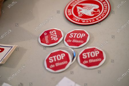 "Buttons that reads, ""Stop De Blasio"" are seen during a Steve Bannon Speaking Engagement on Zoom with Queens Village Republican Club in Triple Crown Diner, Middle Village, Queens, New York on September 3, 2020. (Photo by John Nacion/NurPhoto)"