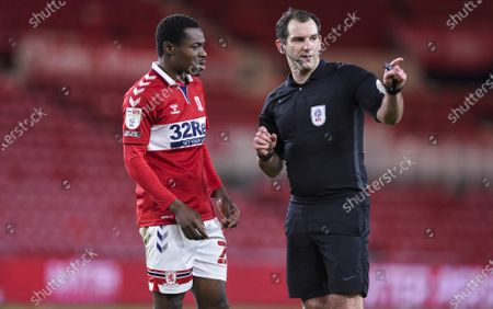 Neeskens Kebano of Middlesbrough and Referee Tim Robinson