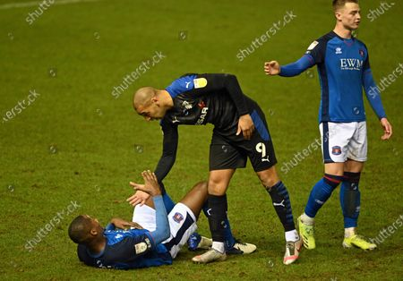 James Vaughan of Tranmere Rovers helps Aaron Hayden of Carlisle United