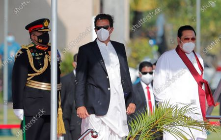Pakistan Prime Minister Imran Khan, center, stands with Sri Lankan Prime Minister Mahinda Rajapaksa, right, after his arrival in Colombo, Sri Lanka, . Khan arrived in Sri Lanka for a two day official visit