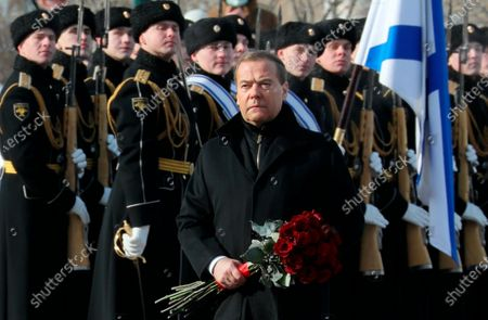 Deputy head of Russia's Security Council and the head of the United Russia party Dmitry Medvedev attends a wreath-laying ceremony at the Tomb of the Unknown Soldier, near the Kremlin during the national celebrations of the 'Defender of the Fatherland Day' in Moscow, Russia, . The Defenders of the Fatherland Day, celebrated in Russia on Feb. 23, honors the nation's military and is a nationwide holiday