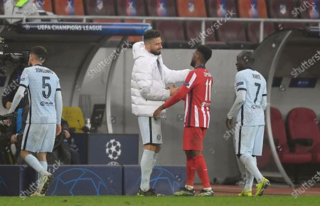 Olivier Giroud of Chelsea speaks with France team mate Thomas Lemar of Atletico Madrid at full time