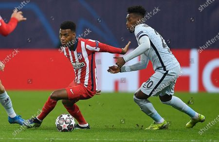 Thomas Lemar of Atletico Madrid and Callum Hudson-Odoi of Chelsea in action