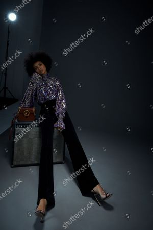 A Model wearing an outfit from the Womens Ready to wear, pret a porter, collections, winter 2021 2022, original creation, during the Womenswear Fashion Week in London, from the house of Edward Crutchley