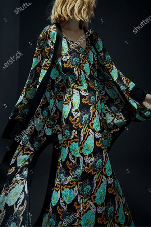Stock Image of A Model wearing an outfit from the Womens Ready to wear, pret a porter, collections, winter 2021 2022, original creation, during the Womenswear Fashion Week in London, from the house of Edward Crutchley