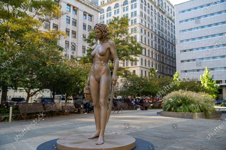 """Newly installed statue of """"Medusa With The Head of Perseus"""" by Argentine-Italian artist Luciano Garbati stands in Collect Pond Park on October 14, 2020 in New York City. In the wake of the #MeToo movement, the seven-foot bronze sculpture changes the narrative of Medusa, offering a different take on the 16th Century Florentine bronze statue of """"Perseus with the Head of Medusa"""" by Benvenuto Cellini. The statue was installed directly across from New York County Criminal Court, the location of many high profile abuse cases including the recent Harvey Weinstein trial. (Photo by John Nacion/NurPhoto)"""