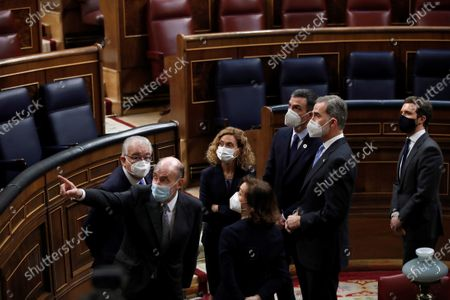 Spanish King Felipe VI (2R) and Prime Minister Pedro Sanchez (3R) next to Popular Party leader, Pablo Casado (R), Lower Chamber of Spanish Parliament, Meritxell Batet (C), First Deputy Prime Minister, Carmen Calvo (4R) Constitutional Court president Juan Jose Gonzalez Rivas and one of the founders of the Constitution law Miquel Roca (2L) visit the Lower House in Madrid, Spain, 23 February 2021, on occasion of the 40th anniversary of the coup d'etat attempt on 23 February 1981 by lieutenant-colonel Antonio Tejero with another 200 armed Civil Guard members during the vote to elect the new Prime Minister.