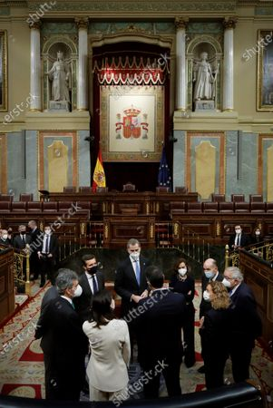 King Felipe VI (C), chats with Spanish Prime Minister, Pedro Sanchez (C, back to camera); First Deputy Prime Minister, Carmen Calvo (4R); Speaker of the Lower Chamber of Parliament, Meritxell Batet (3R), President of the Constitutional Court, Juan Jose Gonzalez Rivas (R); Speaker of the Senate, Pilar Llop (2L, back to camera), President of the Supreme Court, Carlos Lesmes (L), leader of Spanish People's Party, Pablo Casado (2R, facing the camera); and 'father' of the Constitution Miquel Roca (3R), pose during the ceremony held at the Lower House in Madrid, Spain, 23 February 2021, on occasion of the 40th anniversary of the coup d'etat attempt on 23 February 1981 by lieutenant-colonel Antonio Tejero with another 200 armed Civil Guard members during the vote to elect the new Prime Minister.