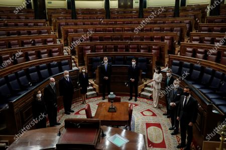 King Felipe VI (5L), Spanish Prime Minister, Pedro Sanchez (5R); First Deputy Prime Minister, Carmen Calvo (L); Speaker of the Lower Chamber of Parliament, Meritxell Batet (4L), President of the Constitutional Court, Juan Jose Gonzalez Rivas (3L); Speaker of the Senate, Pilar Llop (4R), President of the Supreme Court, Carlos Lesmes (3R), leader of Spanish People's Party, Pablo Casado (R); and 'fathers' of the Constitution Miguel Herrero y Rodríguez de Minon (2R) and Miquel Roca (2L), pose during the ceremony held at the Lower House in Madrid, Spain, 23 February 2021, on occasion of the 40th anniversary of the coup d'etat attempt on 23 February 1981 by lieutenant-colonel Antonio Tejero with another 200 armed Civil Guard members during the vote to elect the new Prime Minister.