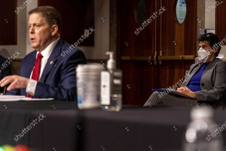 Attorney Debra Katz, right, representing former U.S. Capitol Police Chief Steven Sund, left, sits behind him as he testifies before a Senate Homeland Security and Governmental Affairs & Senate Rules and Administration joint hearing on Capitol Hill, Washington, to examine the January 6th attack on the Capitol