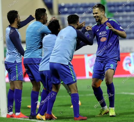 Al-Fateh's player Mitchell Te Vrede (R) celebrates with teammates after scoring a goal during the Saudi Professional League soccer match between Al-Fateh and Al-Ettifaq at Prince Abdullah bin Jalawi Stadium, in Al-Hasa, Saudi Arabia, 23 February 2021.