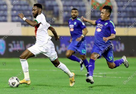 Al-Fateh's player Christian Cueva (R) in action against Al-Ettifaq's Ali Hazazi (L) during the Saudi Professional League soccer match between Al-Fateh and Al-Ettifaq at Prince Abdullah bin Jalawi Stadium, in Al-Hasa, Saudi Arabia, 23 February 2021.