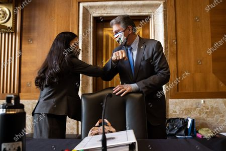 United States Representative Deb Haaland (Democrat of New Mexico), greets US Senator Joe Manchin III (Democrat of West Virginia), Chairman, US Senate Committee on Energy and Natural Resources , before the start of the Senate Committee on Energy and Natural Resources hearing on her nomination to be Interior Secretary, on Capitol Hill in Washington.